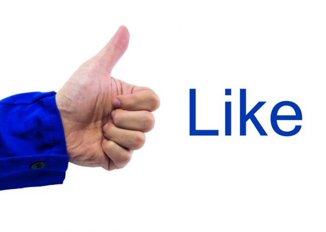 """Facebook: A thumbs-up gesture of human hand with word """"Like"""""""