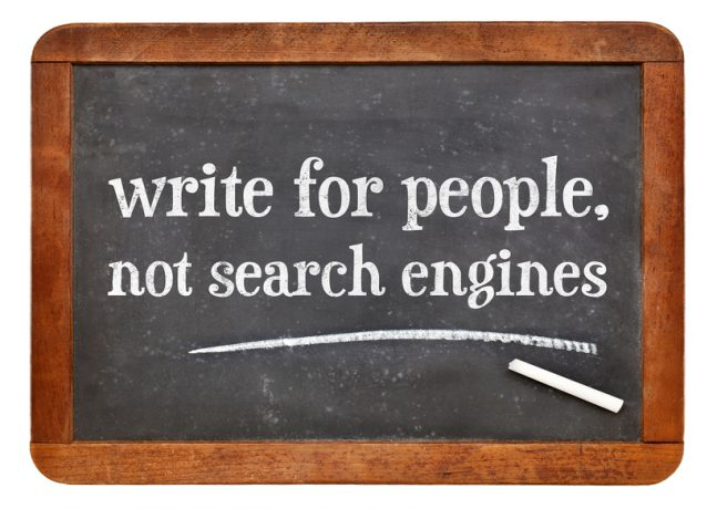write for people, not search engine - creating content advice - white chalk text on a vintage slate blackboard