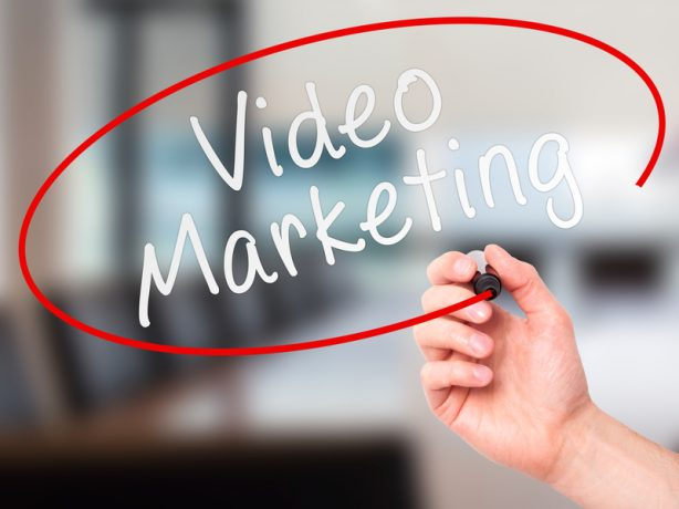Man Hand writing Video Marketing black marker on visual screen. Isolated on office. Business, technology, internet concept. Stock Image