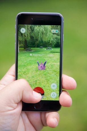 Vancouver, Сanada - July 22, 2016: Closeup of a Pokemon Go player capturing a Pokemon on a smart phone. Pokemon Go is location-based augmented reality game developed for iOS and Android devices. It was released in July 2016.