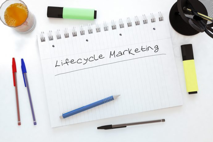 Lifecycle Marketing - handwritten text in a notebook on a desk - 3d render illustration.