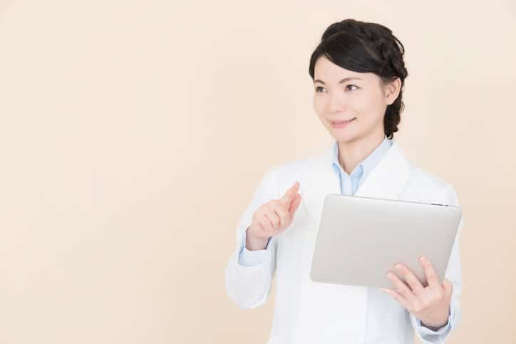 Young woman operating a tablet PC